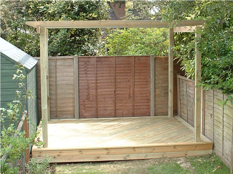Softwood decking set on the diagonal and pergola